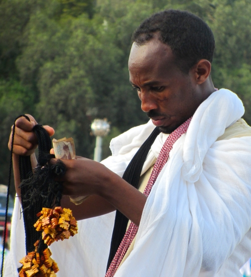 Man selling meskel crosses